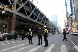 Police officers stand outside the New York Port Authority Bus Terminal. REUTERS/Brendan McDermid