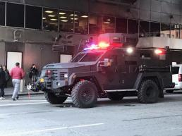 An armored police truck occupies the street outside of the New York Port Authority. REUTERS/Edward Tobin